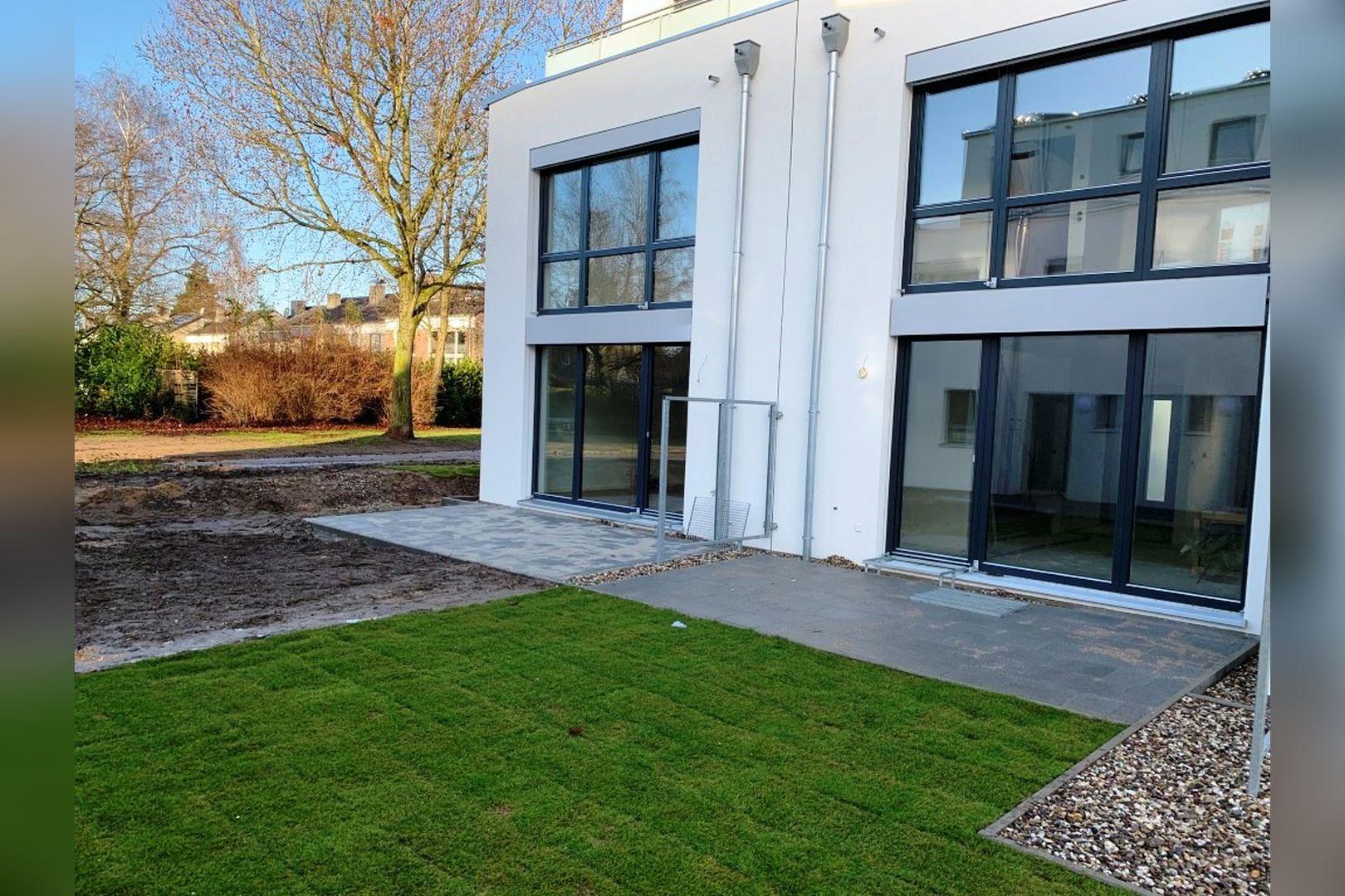 Immobilie Nr.0224 - Reihenendhaus mit kl. Garten u. 2 TG-Plätzen - Bild 2.jpg