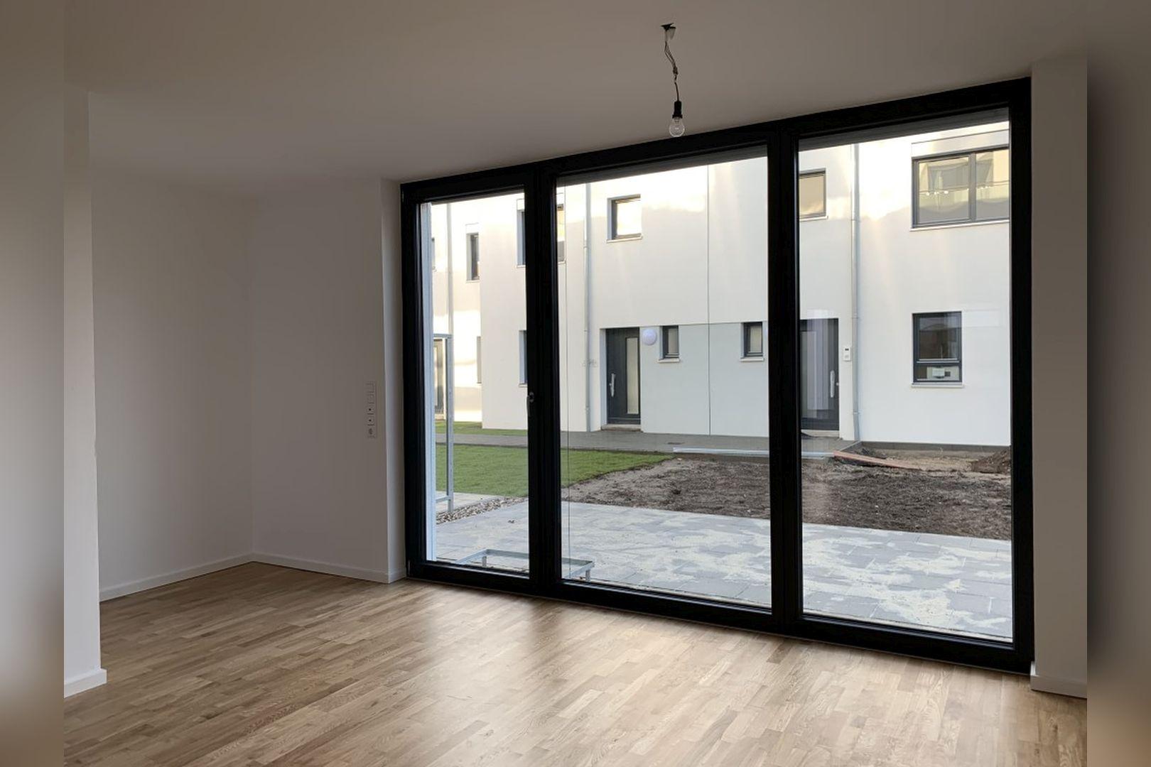 Immobilie Nr.0224 - Reihenendhaus mit kl. Garten u. 2 TG-Plätzen - Bild 4.jpg