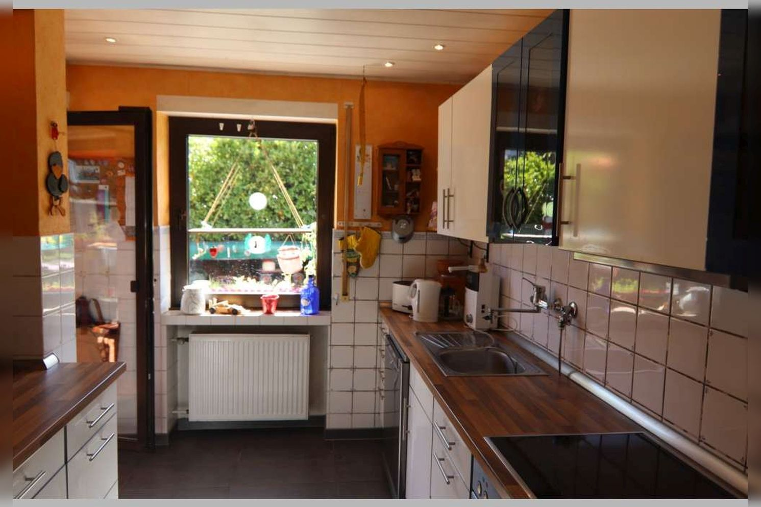 Immobilie Nr.0268 - Reihenmittelhaus mit 4 Zimmern, Küche, Diele, Badezimmer, Gäste-WC, Garten, Garage und Stellplätzen - Bild 12.jpg